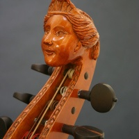 Carved head scroll